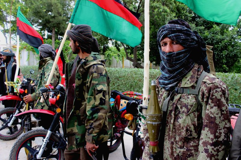 JOWZJAN, May 23, 2016 - Taliban fighters attend a surrender ceremony in Jowzjan province, Afghanistan, May 22, 2016. A total of 16 armed militants gave up fighting and handed over their weapons to ...