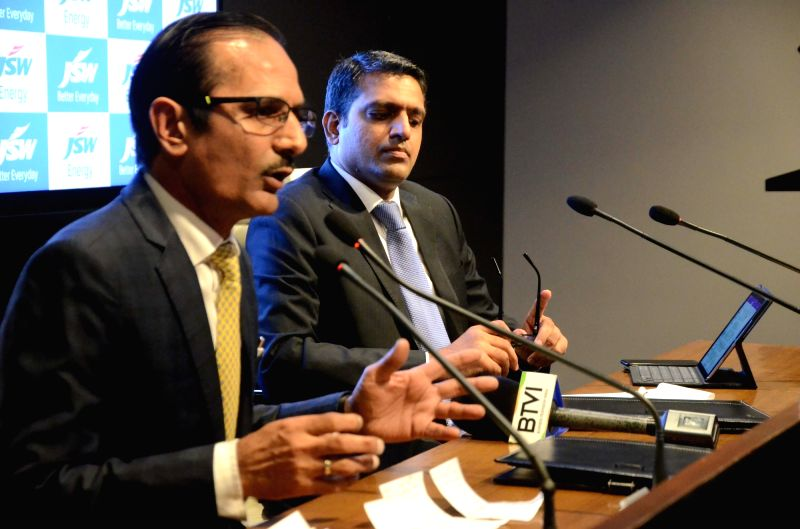 JSW Energy Executive Vice-President Sharad Mahendra addresses during a programme where the JSW Energy's first quarter results to the financial year 2018-19 were announced, in Mumbai, on July ...