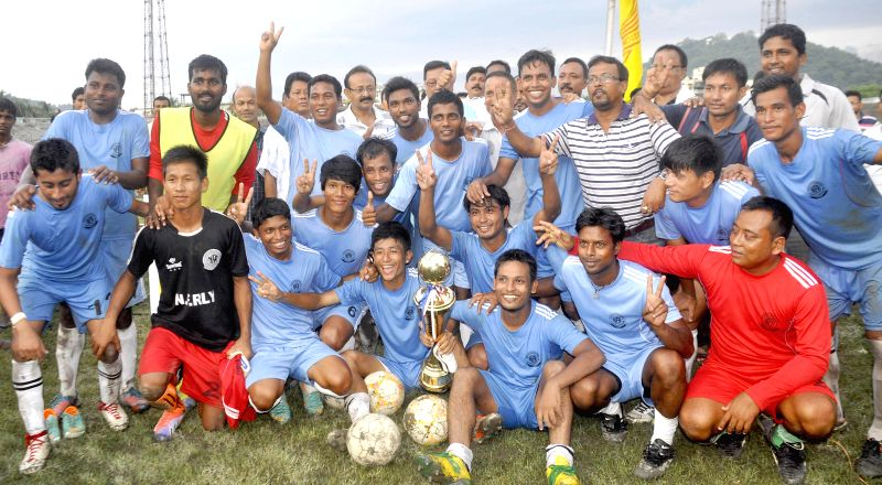 Jubilant North Frontier Railway team with the champion's trophy of 10th NN Bhattacharya Football Tournament after defeating Assam State Electricity Board (ASEB ) at Nehru Stadium in Guwahati on July .