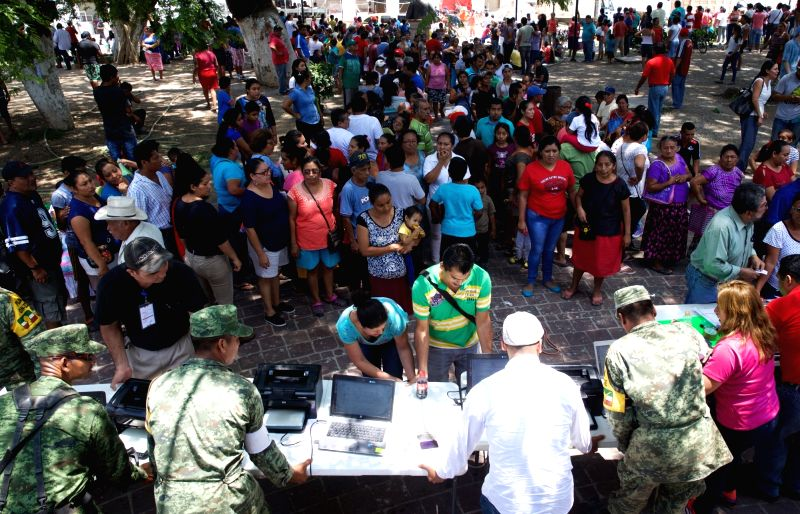 JUCHITAN (MEXICO), Sept. 10, 2017 Local residents register the loss of property to the authority after an earthquake hit in Juchitan, Oaxaca state, Mexico, Sept. 9, 2017. A powerful ...