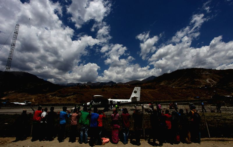 Photo: Local people observe airplanes at an airport in Jumla, Karnali, Nepal, May 8, 2014. The airport located at an elevation of 2,347 metres (7,700 ft) above the sea .