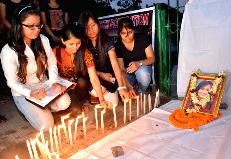 Junior doctors light candles to condole the death of junior doctor Dr. Sarita Toshniwal who was murdered at Assam Medical College Hospital  (AMCH) in Guwahati on May 17, 2014.
