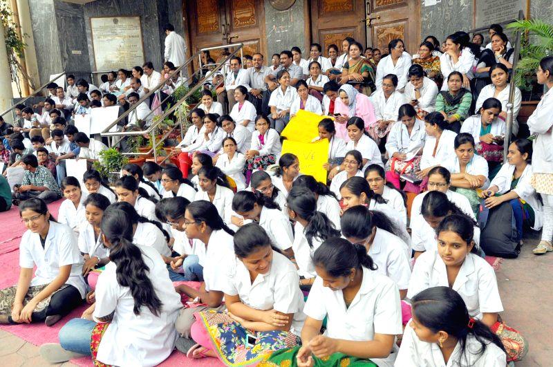 Junior doctors of Gandhi Hospital go on a strike in Hyderabad on July 2, 2014.