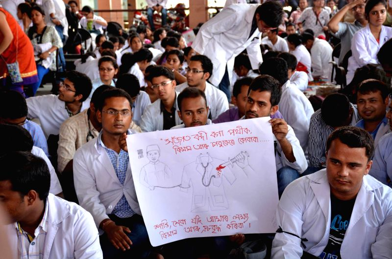 Junior doctors of Guwahati Medical College Hospital (GMCH) stage a sit-in demonstration against murder of a junior doctor at Assam Medical College Hospital (AMCH) in Dibrugarh, at GMCH premises in ...