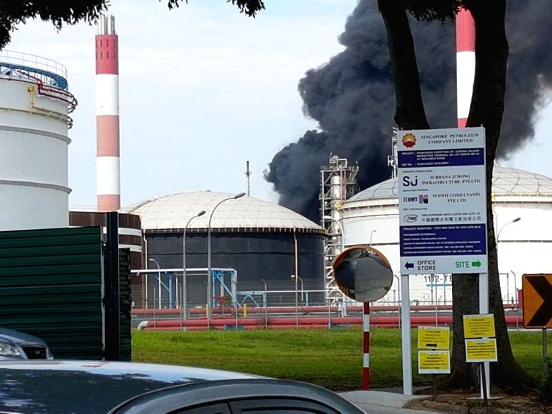 JURONG ISLAND, June 13, 2017 - Photo taken on June 13, 2017 shows smoke rising from the premises of the Singapore Refining Company (SRC) on Jurong Island, Singapore. A fire broke out in the SRC plant ...