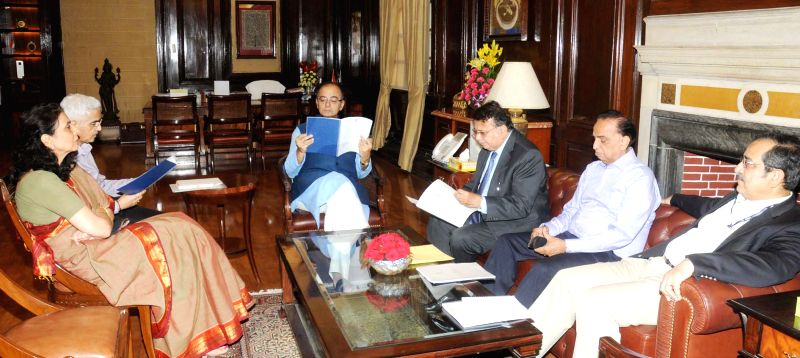 Justice A.P. Shah Committee submit its report on MAT (Minimum Alternate Tax) to the Union Minister for Finance, Corporate Affairs and Information and Broadcasting Arun Jaitley, in New ...