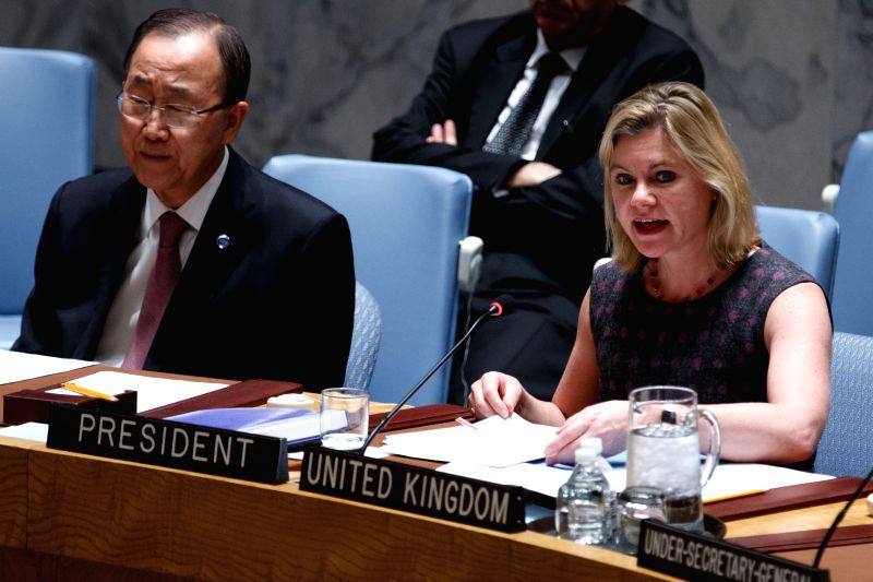 """Justine Greening (R), Secretary of State for International Development of the United Kingdom, chairs a UN Security Council meeting on """"Security, Development ..."""