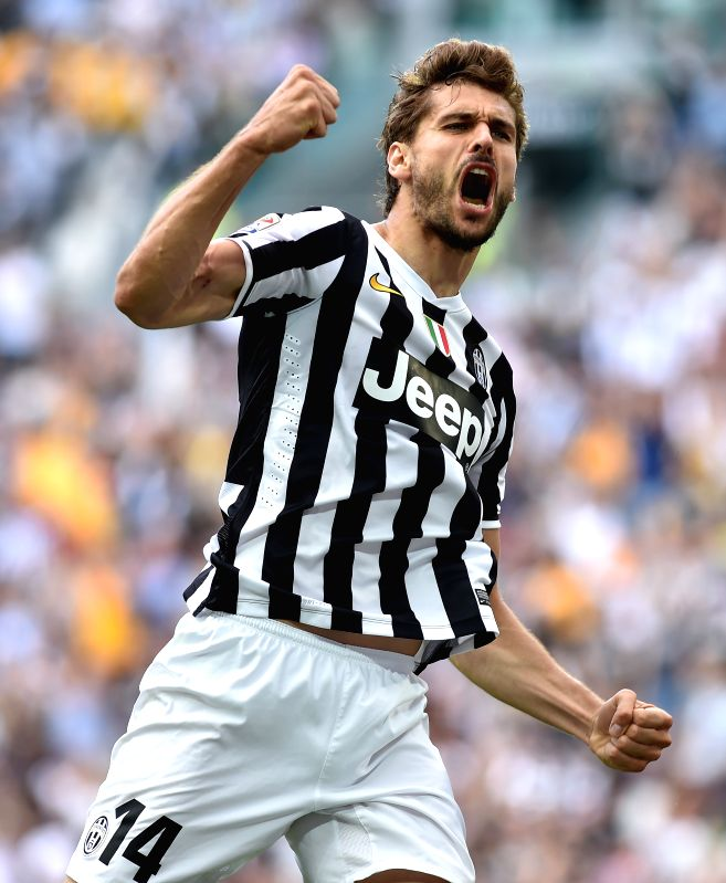 Juventus' Fernando Llorente celerates scoring during the Italian Serie A soccer match against Cagliari in Turin, Italy, May 18, 2014. Champions Juventus became the .