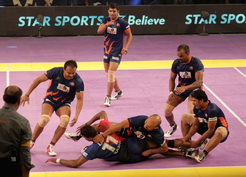 Kabbadi players of Bengal Warriors and Dabang Delhi in action during a Pro Kabaddi League match at Netaji Indoor Stadium in Kolkata on July 31, 2014. Bengal Warriors won the match. (Score - 42 - 40).