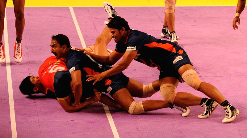 Kabbadi players of Bengal Warriors and Puneri Paltan in action during a Pro Kabaddi League match at Netaji Indoor Stadium in Kolkata on August 1, 2014