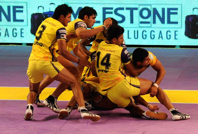 Kabbadi players of Patna Pirates and Telugu Titans in action during a Pro Kabaddi League match at Netaji Indoor Stadium in Kolkata on August 1, 2014.