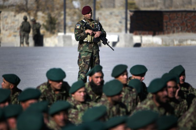 Afghan Army soldiers attend their graduation ceremony in Kabul Afghanistan on November 23, 2014. A total of 1,500 army soldiers graduated after three months of training in Kabul Sunday. ...