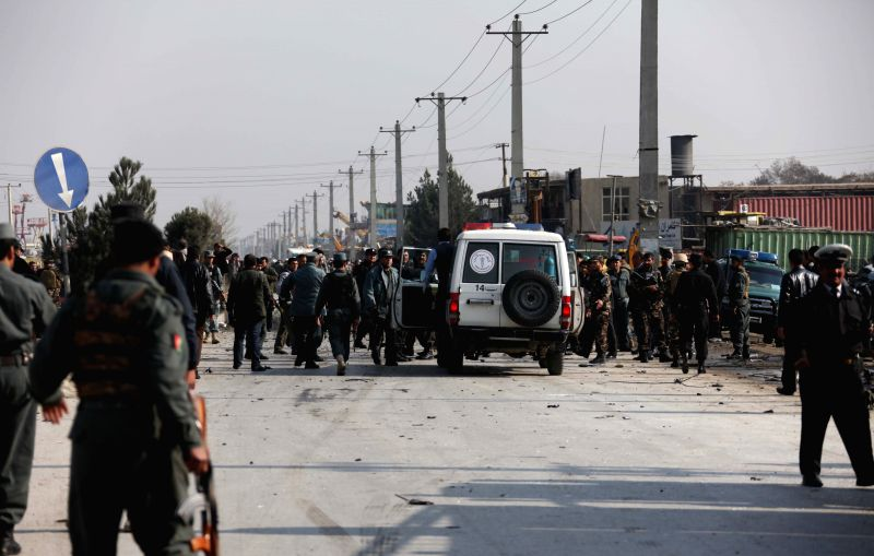 Afghan security forces inspect the site of suicide bombing in Kabul, Afghanistan, Nov. 27, 2014. At least five Afghan civilians were killed and 34 others wounded Thursday morning after a ...