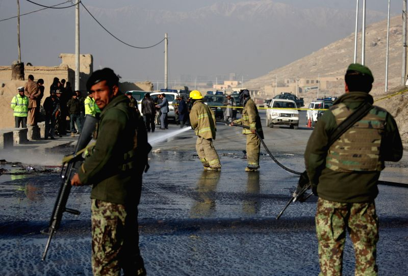 Afghan security forces keep watching at the site of a suicide bombing in Kabul, Afghanistan, Dec. 11, 2014. A suicide bomber blew himself up next to a bus of national army personnel in Tangi ..