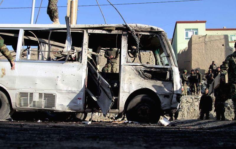 """Afghan security forces transfer a destroyed bus which is targeted by a suicide bombing in Kabul, Afghanistan, Dec. 11, 2014. """"A suicide bomber blew himself up next to a bus of national ..."""