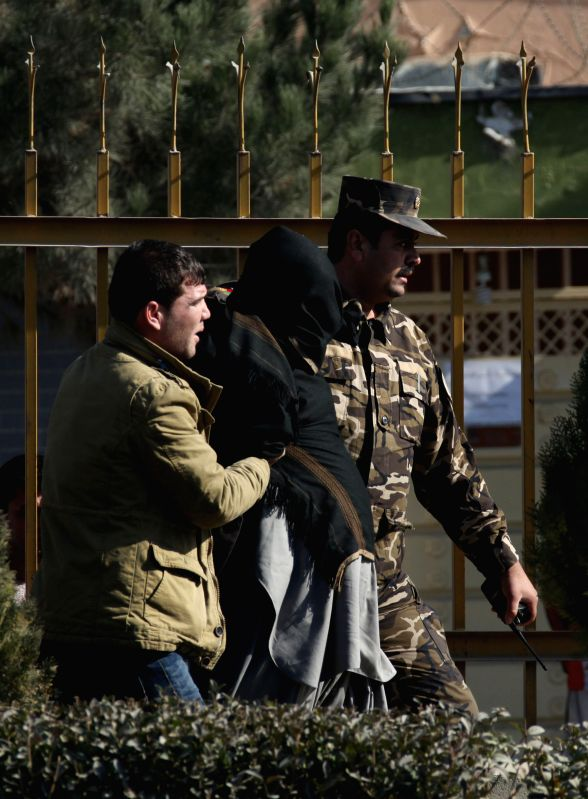 Afghan security officers escort a suspected man following a blast in Kabul, Afghanistan, Nov. 25, 2014. A big blast rocked the Afghan capital of Kabul on Tuesday but caused no casualties, ...