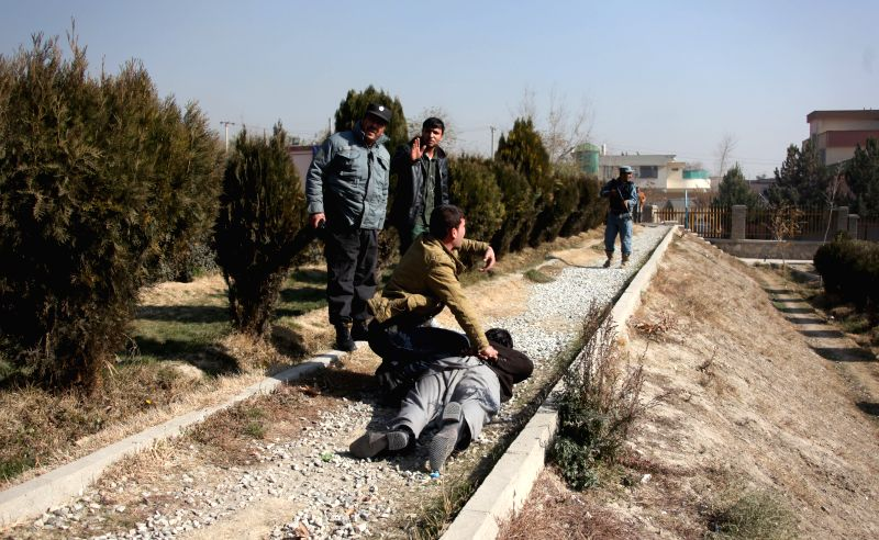 Afghan security officers try to handcuff a suspected man fallowing a blast in Kabul, Afghanistan, Nov. 25, 2014. A big blast rocked the Afghan capital of Kabul on Tuesday but caused no ...
