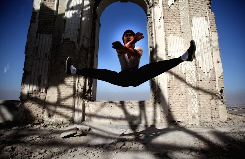 "Kabul (Afghanistan ): Abbas Alizada, an Afghan youth who calls himself the Afghan Bruce Lee, shows his skills during the exercise at a destroyed palace in Kabul, Afghanistan, Dec. 11, 2014. ""I .."