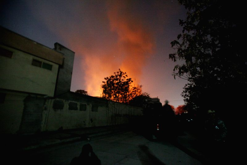 Kabul (Afghanistan): Smoke rises from a building which was occupied by Taliban militants in Kabul, Afghanistan, on Nov. 29, 2014. Five people were killed and several others wounded after Taliban ...