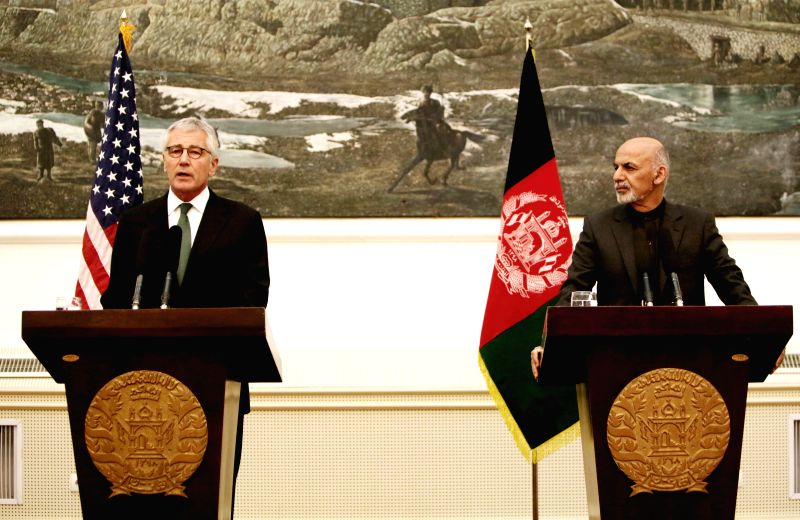 Kabul (Afghanistan): U.S. Defense Secretary Chuck Hagel (L) speaks during a joint press conference with Afghan President Mohammad Ashraf Ghani in Kabul, Afghanistan, Dec. 6, 2014. Visiting U.S. ...