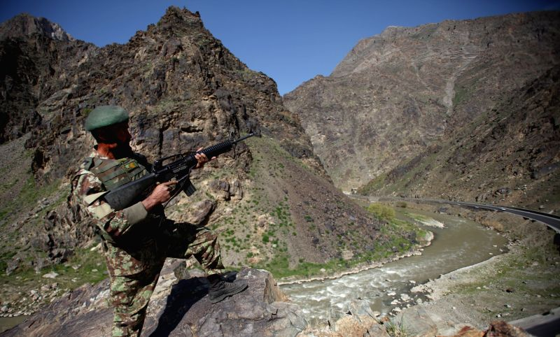 An Afghan National Army soldier stands guard at an army checkpoint on the outskirt of Kabul, Afghanistan, April 13, 2015.