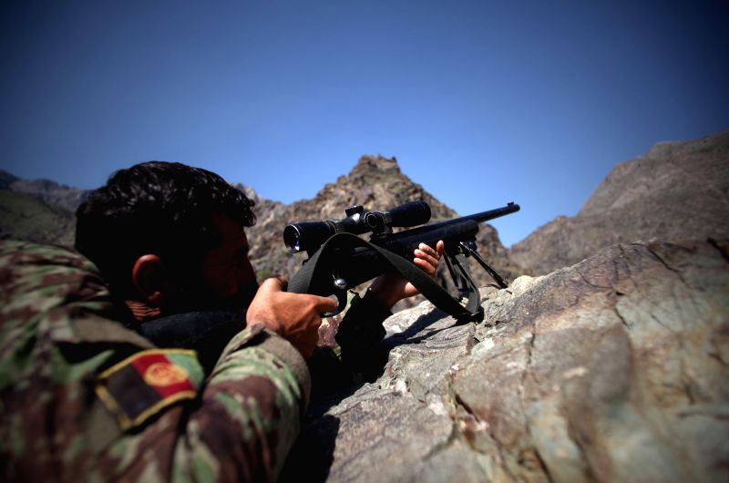 An Afghan national army soldier aims his gun at an army checkpoint on the outskirt of Kabul, Afghanistan on April 13, 2015. More than 20 security personnel had been ...