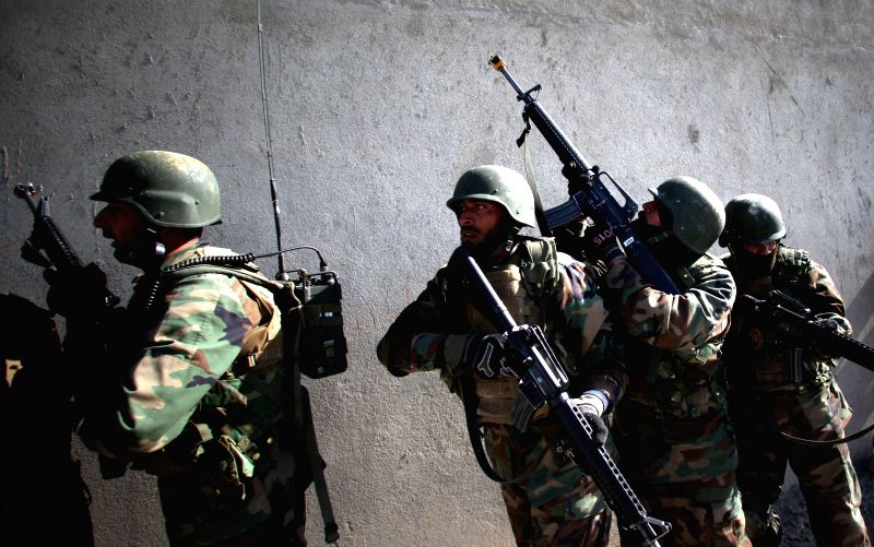 Afghan National Army soldiers take part in a military exercise at an army training center in Kabul, Afghanistan on April 28, 2015. A key Taliban leader was killed ...