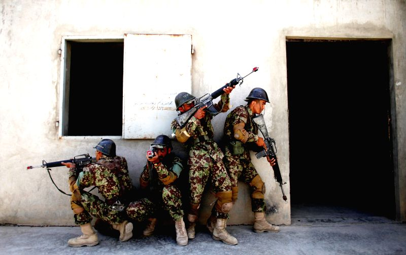 Afghan national army soldiers take part in a training at a military camp in Kabul, Afghanistan, April 5, 2015.