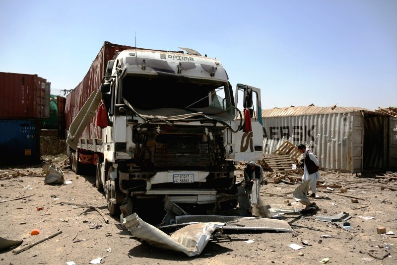 KABUL, Aug. 1, 2016 - Afghan men check the debris at the site of a truck bombing attack in Kabul, capital of Afghanistan, Aug. 1, 2016. One police and three militants were killed and three police ...