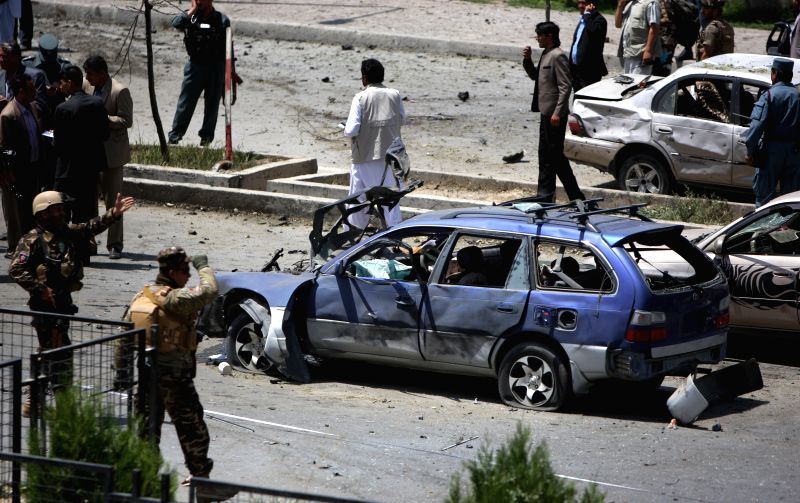Destroyed vehicles are seen  at the site of suicide car bomb blast in Kabul, Afghanistan, Aug. 10, 2014. A suicide car bomb hit Kabul city on Sunday, leaving at least
