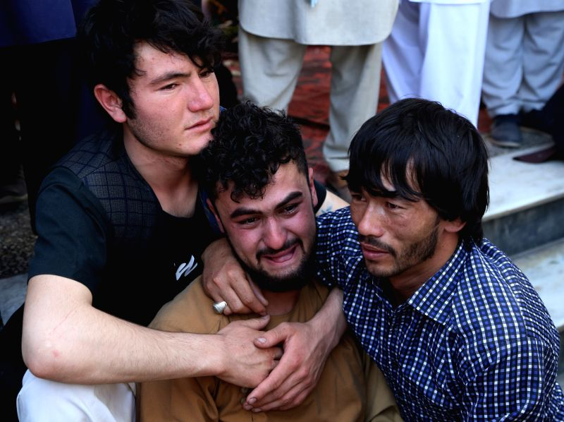 KABUL, Aug. 18, 2019 (Xinhua) -- An Afghan man cries over his brother's death in a suicide attack during a funeral ceremony in Kabul, capital of Afghanistan, Aug. 18, 2019. An explosion ripped through a packed wedding hall in Kabul late on Saturday e