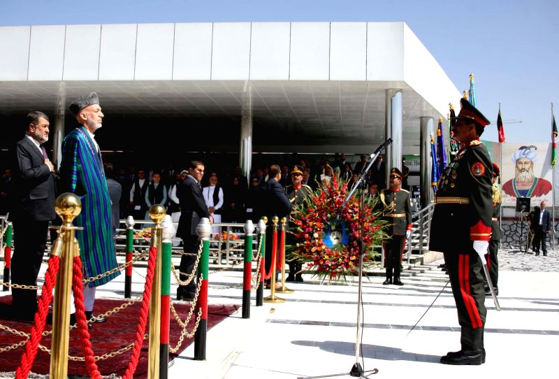Afghan President Hamid Karzai (2nd L) attends the celebration of Afghan Independence Day in Kabul, Afghanistan, Aug. 19, 2014. Afghanistan marked the 95th anniversary