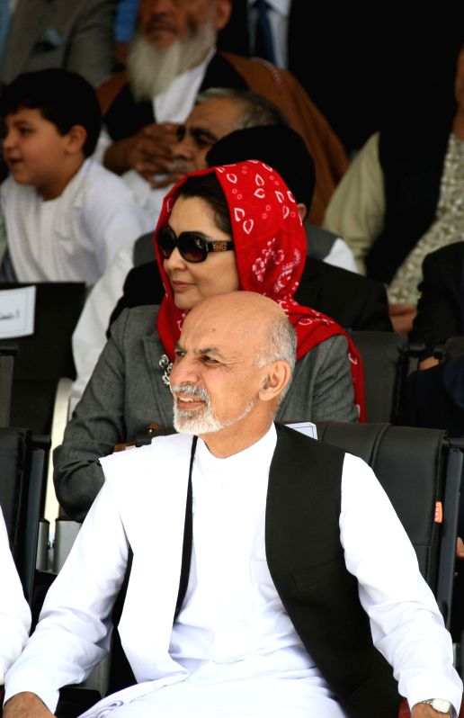 Presidential candidate Ashraf Ghazni Ahmadzi (front) attends the celebration of Afghan Independence Day in Kabul, Afghanistan, Aug. 19, 2014. Afghanistan marked the ..
