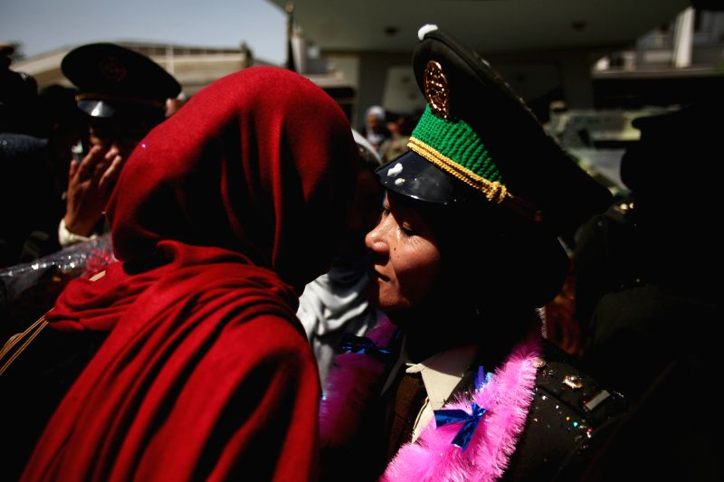 A  newly-graduated female Afghan National Army (ANA) officer(R) hugs her relative after graduation ceremony in Kabul, Afghanistan on Aug. 24, 2014. A total of 30 ...