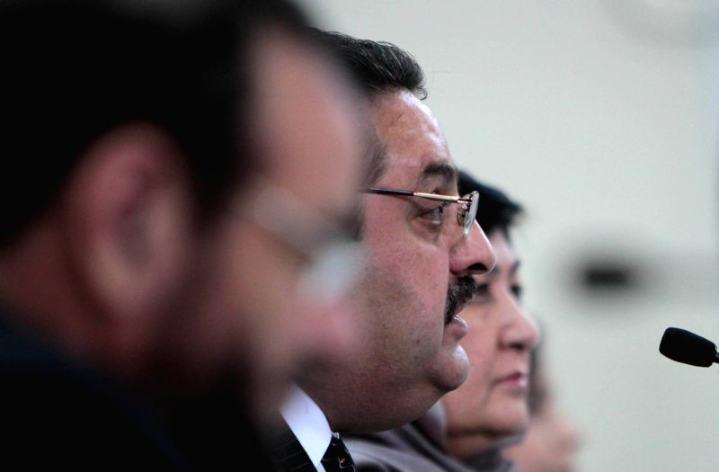 Afghanistan's deputy chairman of the election commission Abdul Rahman Hotaki speaks during a press conference in Kabul, Afghanistan, on Aug. 25, 2014. Afghan election
