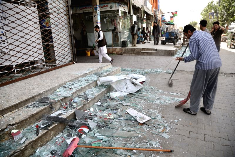 KABUL, Aug. 7, 2019 (Xinhua) -- Local people clean the debris left after an explosion in Kabul, capital of Afghanistan, on Aug. 7, 2019. At least 95 people were wounded after a massive car bomb explosion ripped through a busy neighborhood at the west