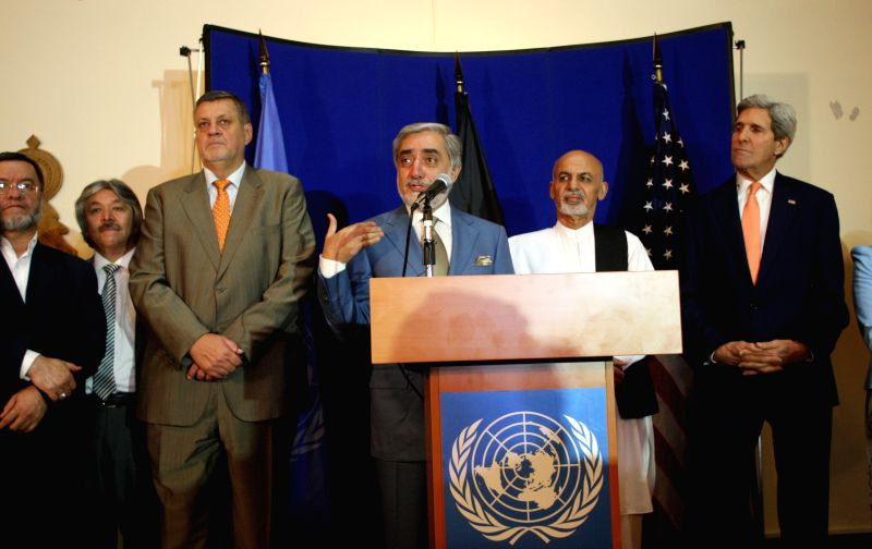 Afghan presidential candidate Abdullah Abdullah (L4) speaks during a joint press conference in Kabul, Afghanistan on Aug. 8, 2014. Both Afghan presidential candidates .