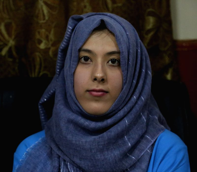 KABUL, Aug 9, 2018 - Tahmina Payenda poses for photos after a ceremony in Kabul, capital of Afghanistan, Aug. 5, 2018. TO GO WITH Feature: Girl tops Afghan's varsity entry test results, vows to fight ...