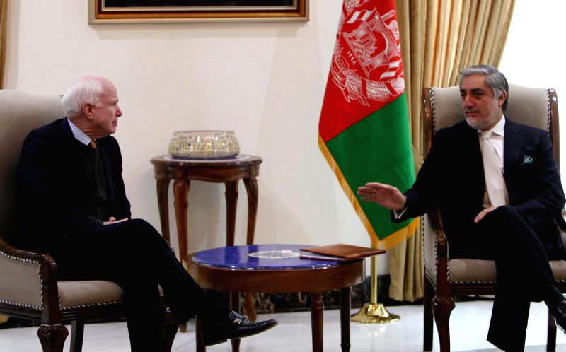 Afghan Chief Executive Officer Abdullah Abdullah (R) talks with U.S. Senator John McCain in Kabul, Afghanistan, Dec. 25, 2014.