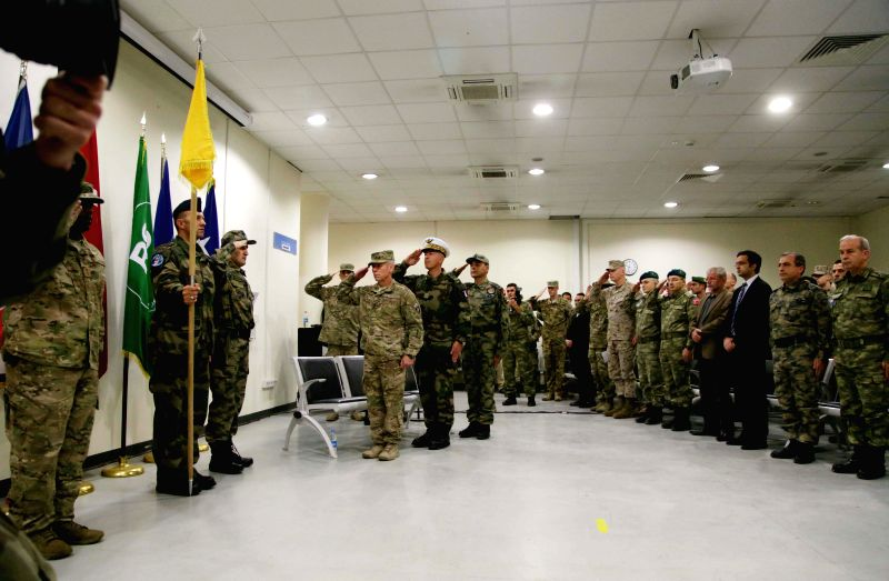 Members of the NATO-led International Security Assistance Force (ISAF) attend the change of command ceremony of Hamid Karzai International Airport from France to ...