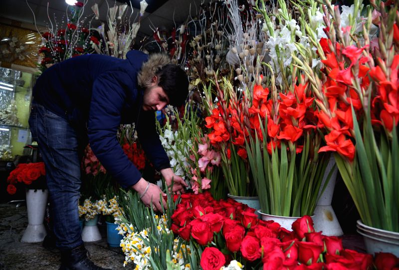 KABUL, Feb. 13, 2018 - A vendor prepares flowers ahead of the Valentine's Day at a flower shop in Kabul, capital of Afghanistan, Feb. 13, 2018. Traditionally, most Afghans are unaware of the ...