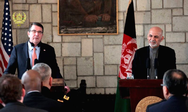 The new U.S. Defense Secretary Ashton Carter (L) speaks during a joint press conference with Afghan President Ashraf Ghani (R) in Kabul, Afghanistan, Feb. 21, 2015. ...