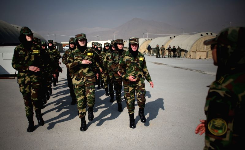 Afghan female National Army officers march during a graduation ceremony at an army training center in Kabul, Afghanistan, Feb. 5, 2015. A total of 272 National Army ...