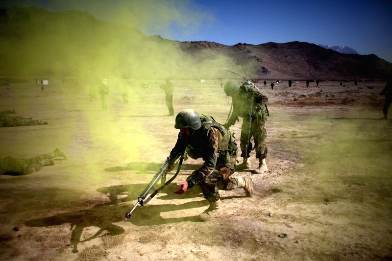 Afghan national army soldiers take positions during a training at an army training center in Kabul, Afghanistan, Feb. 8, 2015.