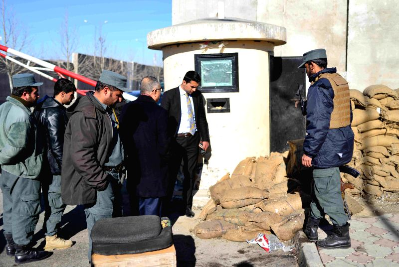 KABUL, Jan. 11, 2017 - People check the site of the blasts in Kabul, Afghanistan, Jan. 11, 2017. In Kabul's two suicide bombings on Tuesday for which Taliban militants have claimed responsibility, 28 ...