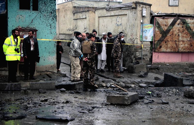 Afghan security forces inspect the site of blast in Kabul, Afghanistan, Jan. 13, 2015. Two civilians were killed while two others wounded in a bomb attack in Afghan ..