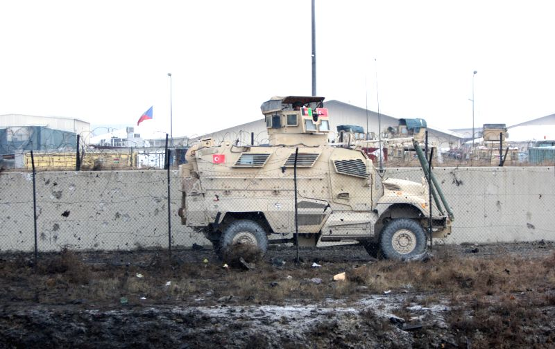 Photo taken on Jan. 25, 2015 shows a foreign military vehicle patrolling following a suicide car bombing in Kabul, Afghanistan. One attacker was killed and two ...