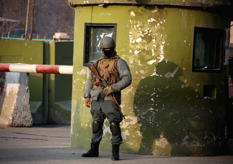 KABUL, Jan. 28 A policeman stands guard at the site of a deadly suicide attack in Kabul, Afghanistan, Jan. 28, 2018. A suicide bombing has killed 95 people and injured at least 158 others ...