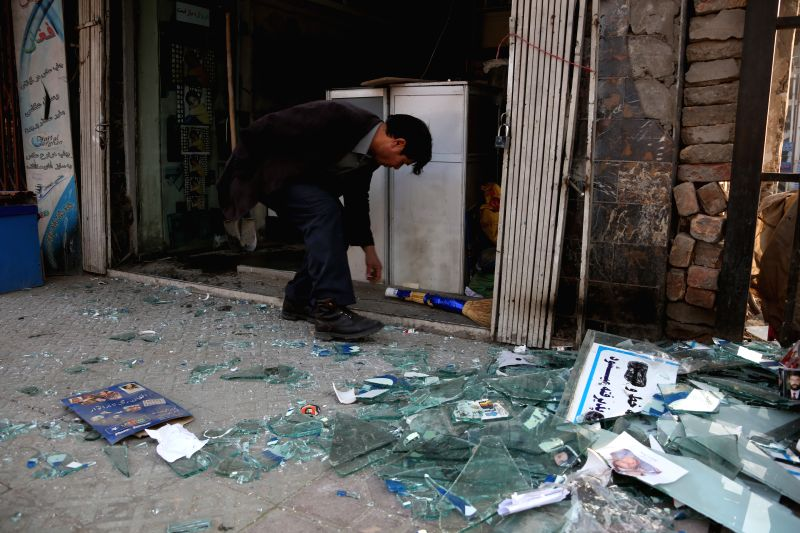 KABUL, Jan. 28  An Afghan man cleans broken glasses of his shop near the site of a deadly suicide attack in Kabul, Afghanistan, Jan. 28, 2018. A suicide bombing has killed 95 people and ...