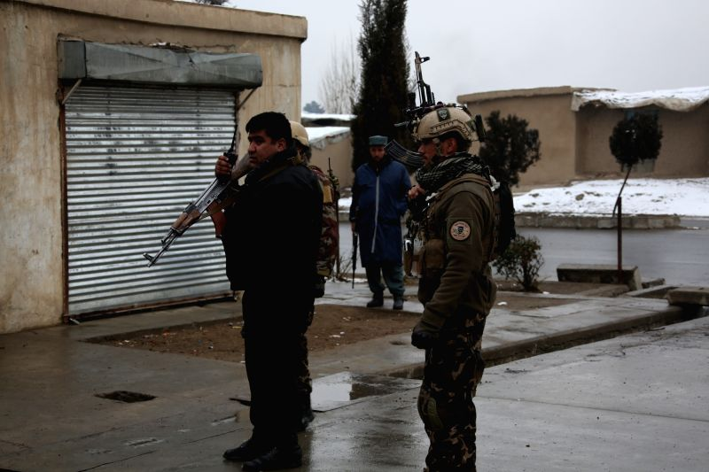 KABUL, Jan. 29, 2018 - Afghan security personnel cordon off the site of the attack on a military university in Kabul, capital of Afghanistan, on Jan. 29, 2018. Gunmen attacked a military university ...